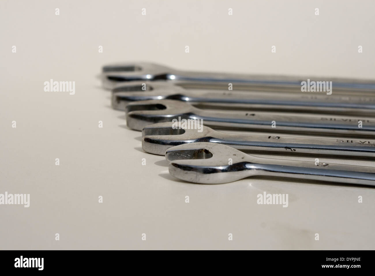 a row of spanners on a white back ground - Stock Image