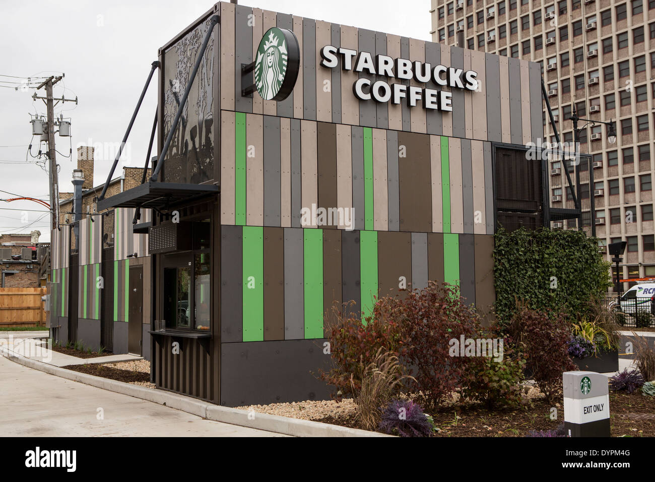 Starbucks Coffee shop built out of recycled shipping containers in Chicago, Illinois USA. Located at the corner of Broadway and Devon the drive-thru only store is part of Starbucks' strategy to develop store concepts from re-purposed materials. Stock Photo