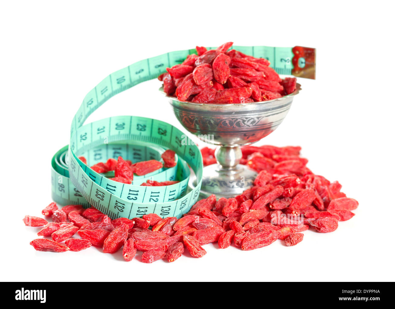 goji berries with a measuring meter isolated on white background - Stock Image