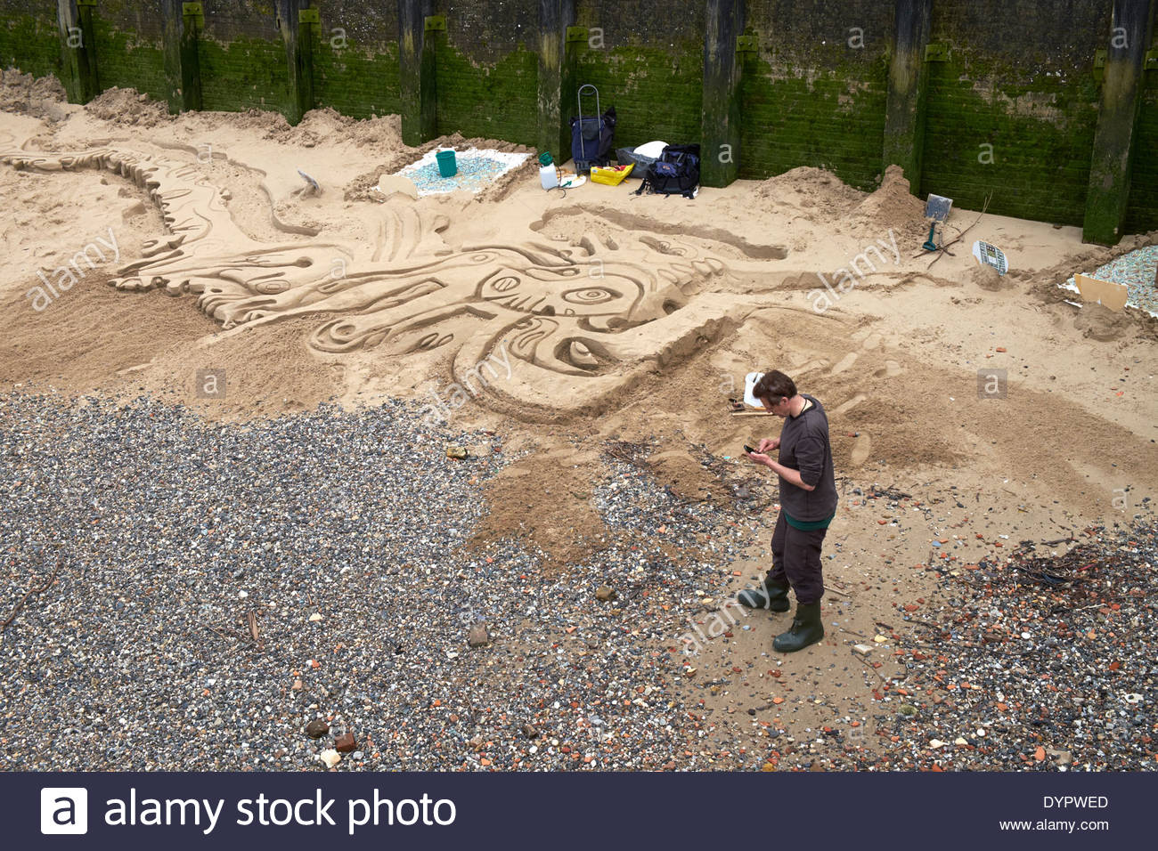 Sand Sculptor, Thames foreshore, South Bank, London - Stock Image