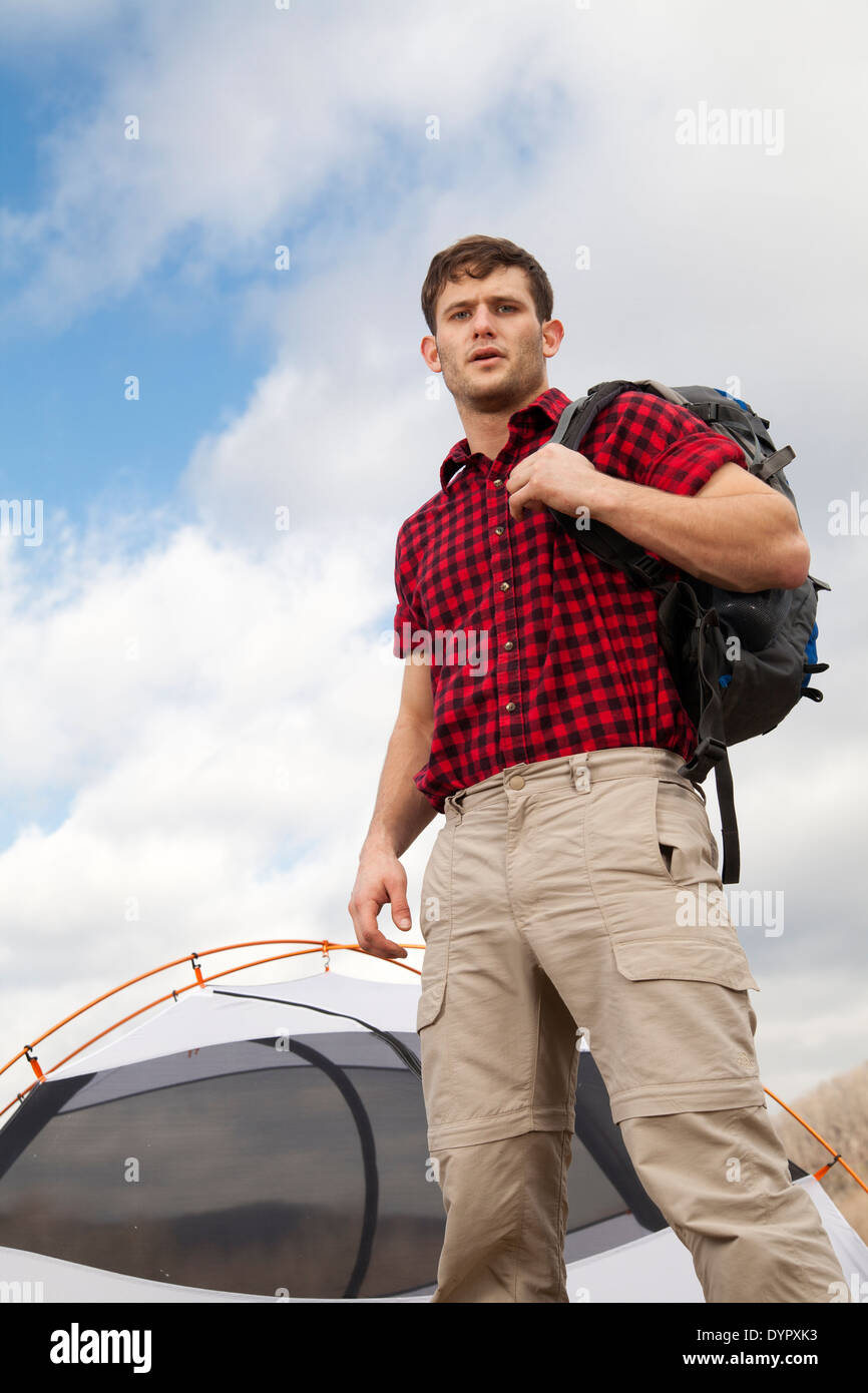 hiker sets up camp with tents and fire pit - Stock Image