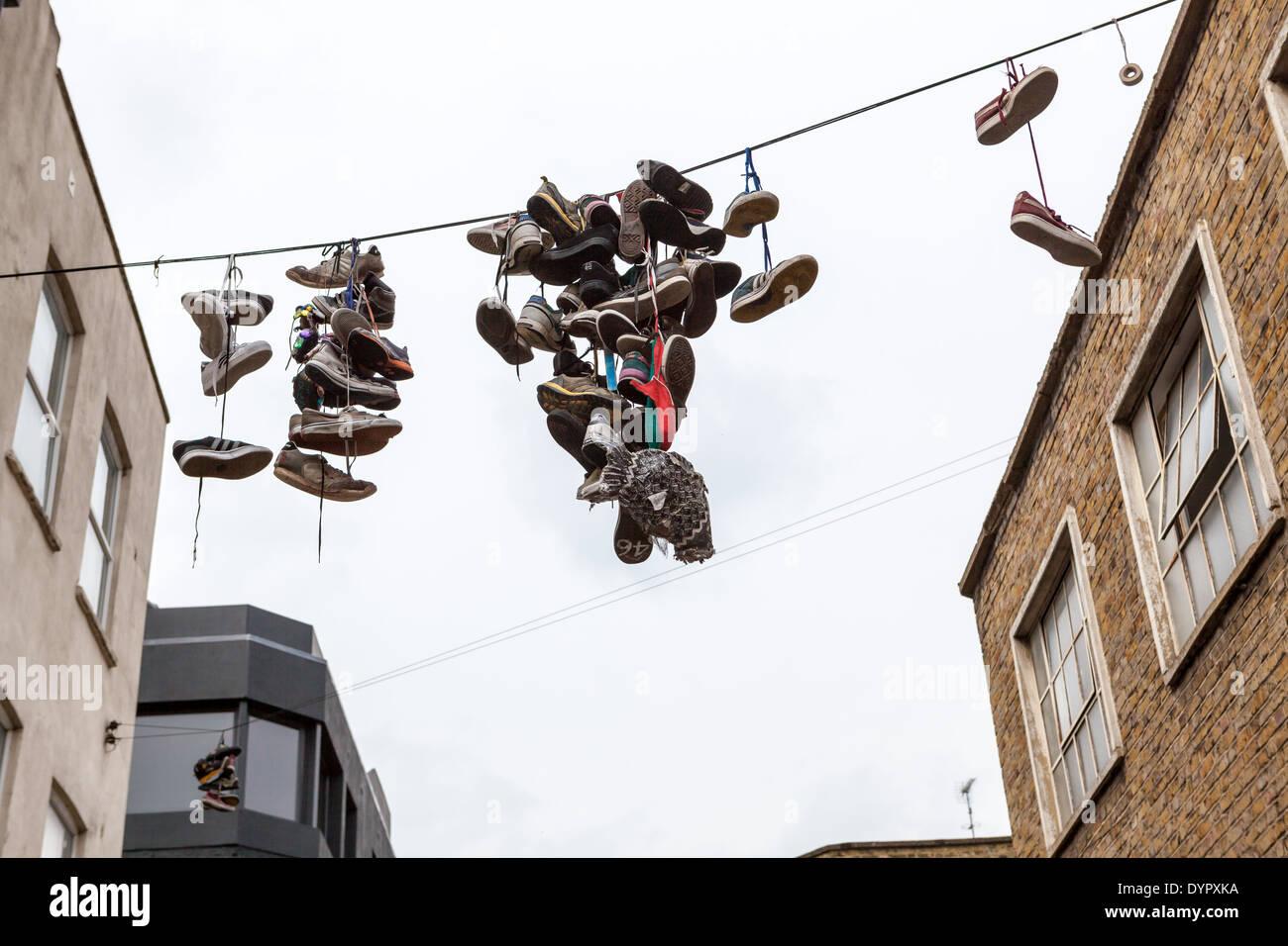"""shoefiti"": shoes + graffiti, in Shoreditch, London - Stock Image"