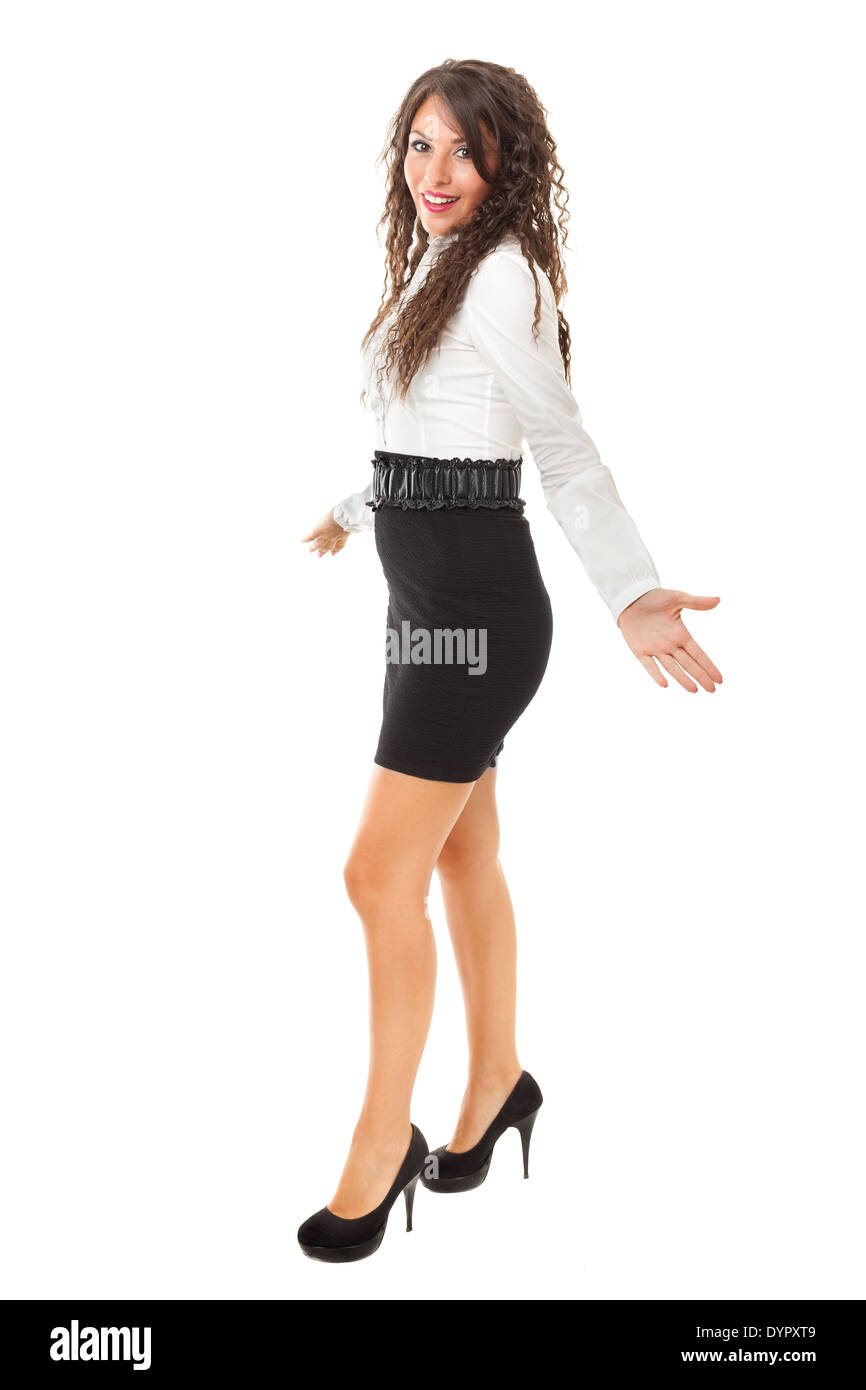 A beautiful and elegant business woman over a white background - Stock Image
