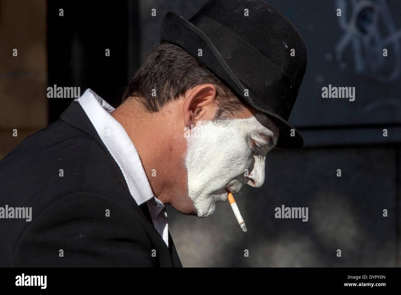Clown with a cigarette, street busker, Prague, Czech Republic - Stock Image