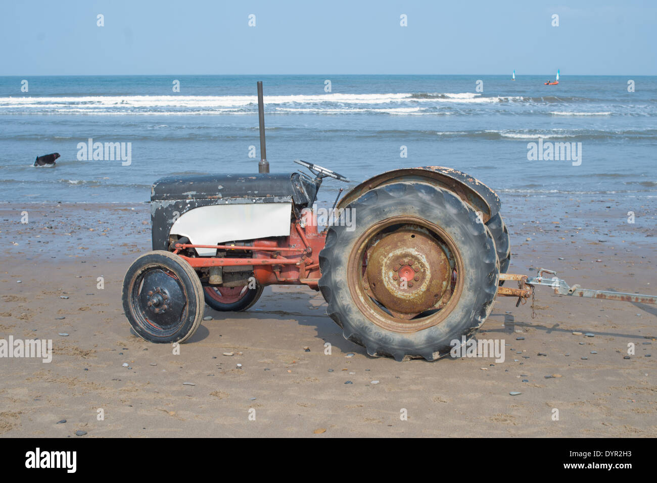 Old tractor used to tow boats Stock Photo