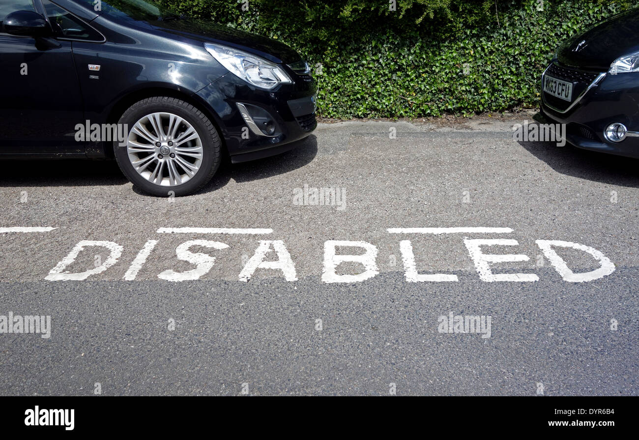cars parked in a disabled parking bay - Stock Image