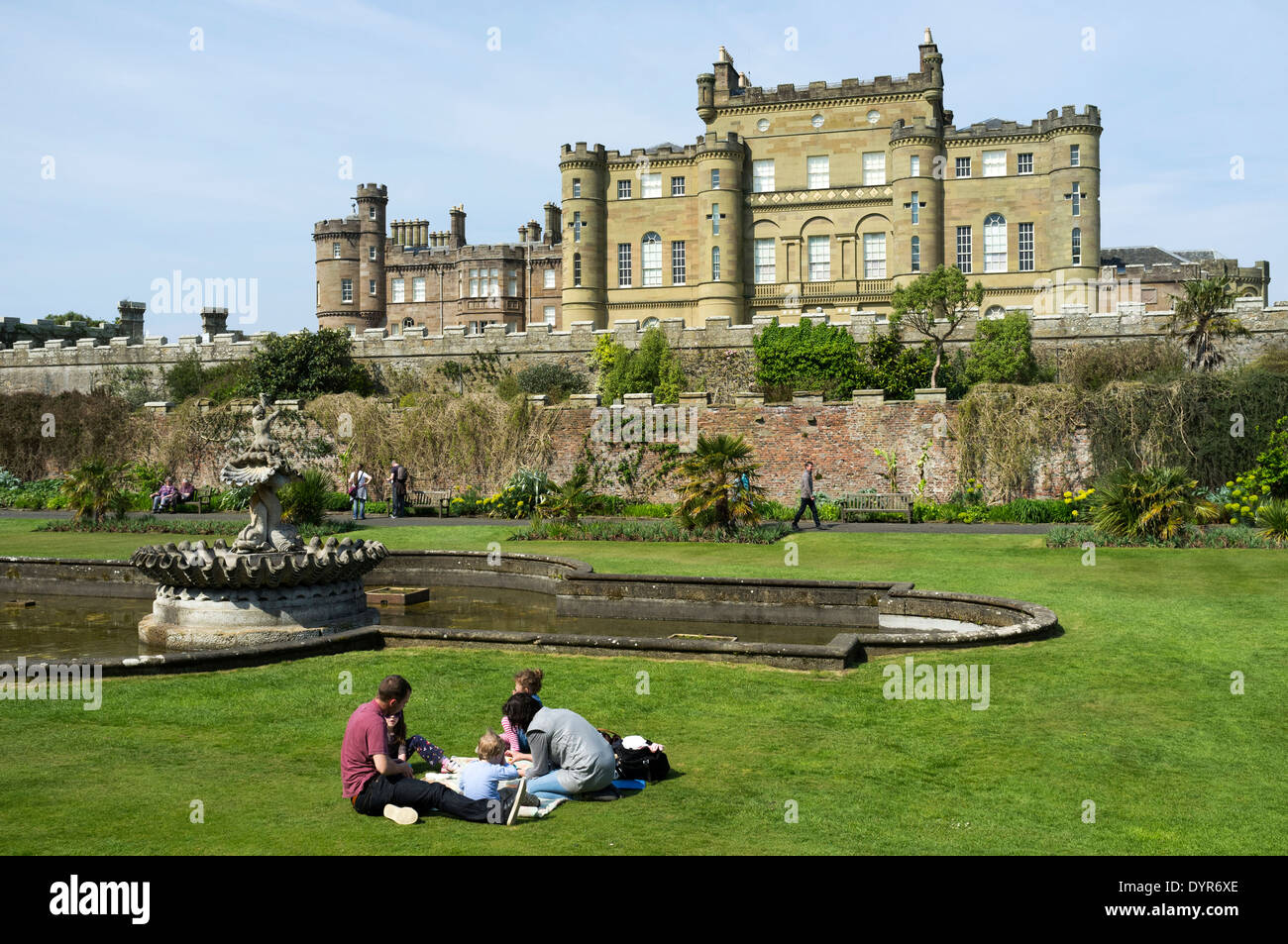 Family having a picnic in the grounds of Culzean Castle, Ayrshire, Scotland, UK - Stock Image