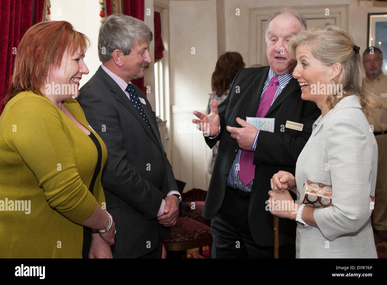 Coleford, Gloucestershire, UK. 24th Apr, 2014. Peter Hands of Speech House Hotel present Mr Nick Horton and Samm Jarman to HRH The Countess of Wessex. Mr Hortons company Royal Forest Pennant donated repairs to the scheduled monument which marks the center of the historic forest. Credit:  David Broadbent/Alamy Live News - Stock Image