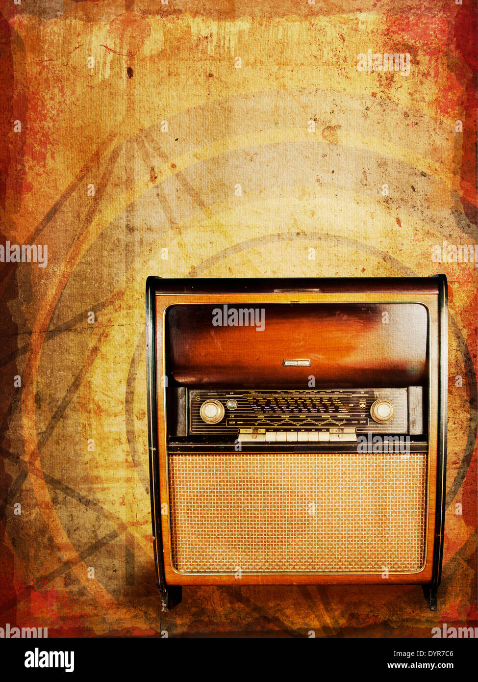 Old vintage radio, an original from the 1950s, against distressed abstract background. - Stock Image