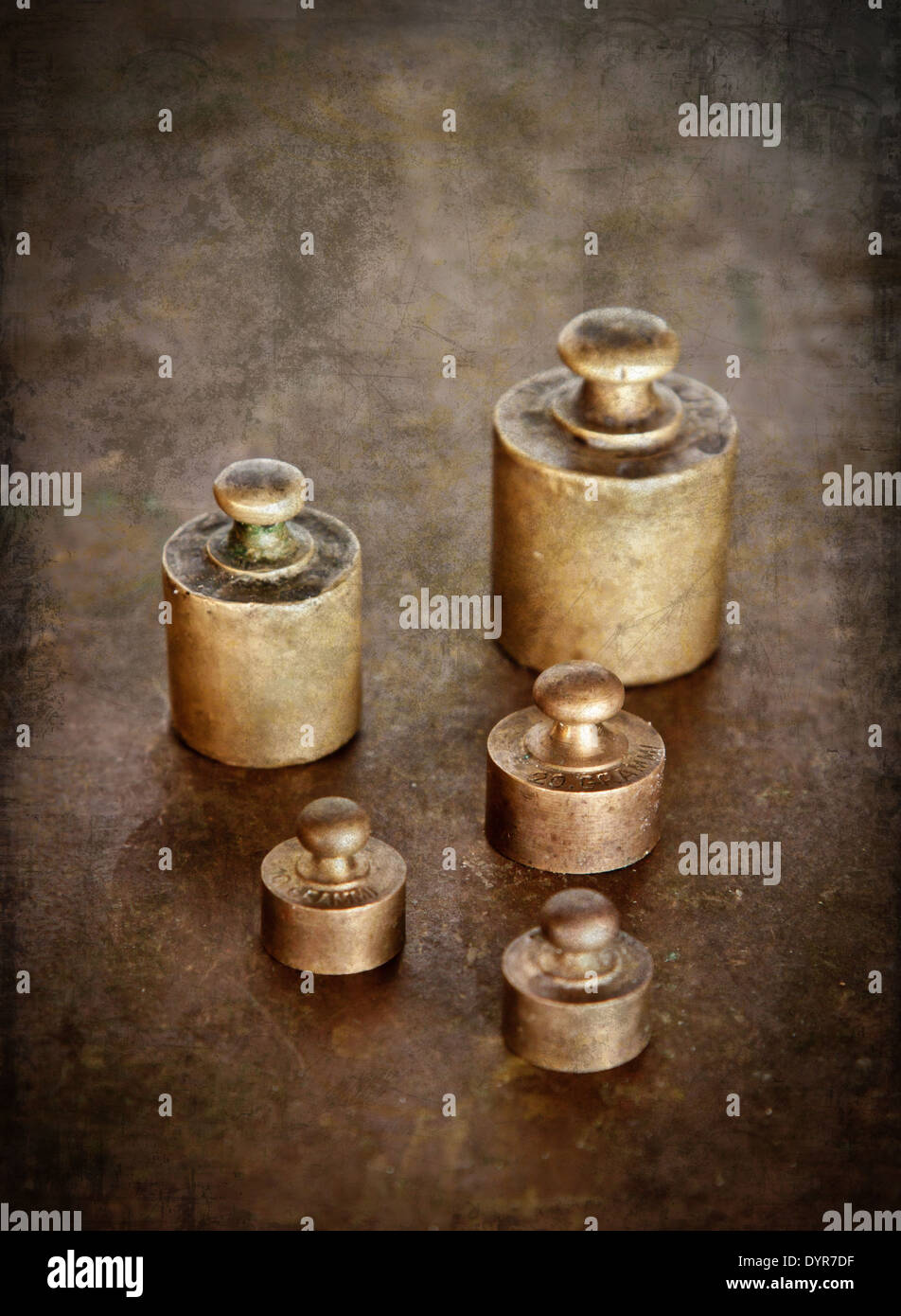 Vintage brass weights. Distressed texture for a retro feel. - Stock Image