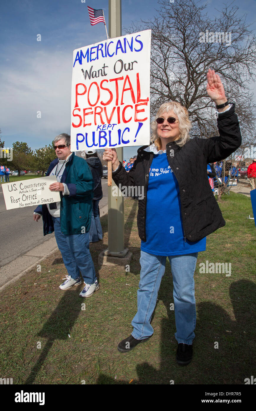 Dearborn, Michigan USA - Members of postal worker unions picket a Staples store to protest the U.S. Postal Service's Stock Photo