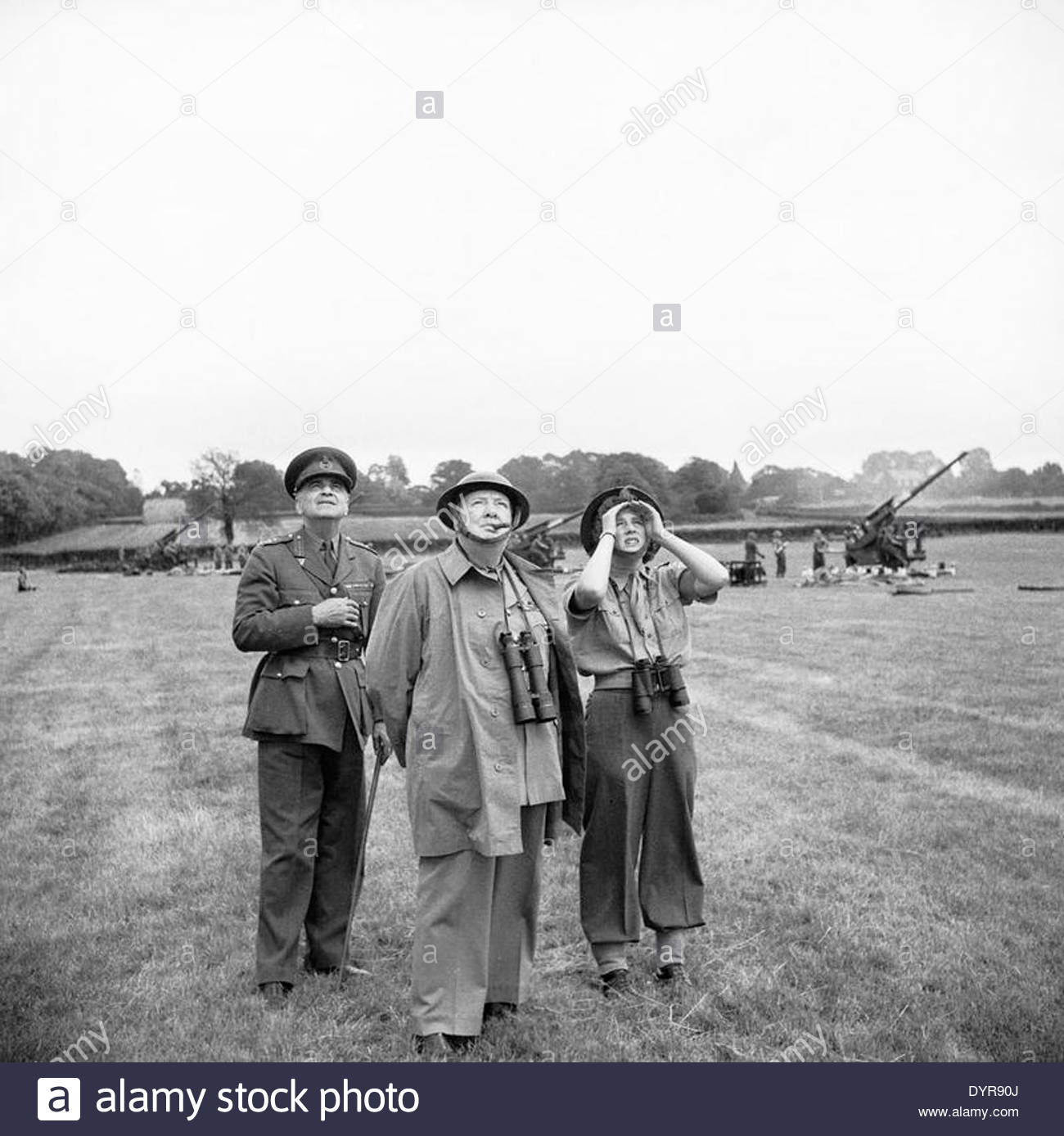 Winston Churchill with his daughter Mary and General Sir Frederick Pile (GOC Anti-Aircraft Command) watch anti-aircraft guns in - Stock Image