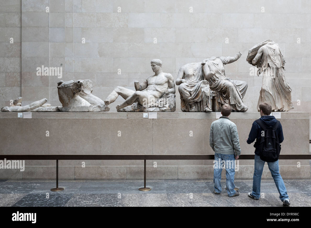 Tourists in front of the East Pediment of Parthenon in British Museum in London. - Stock Image