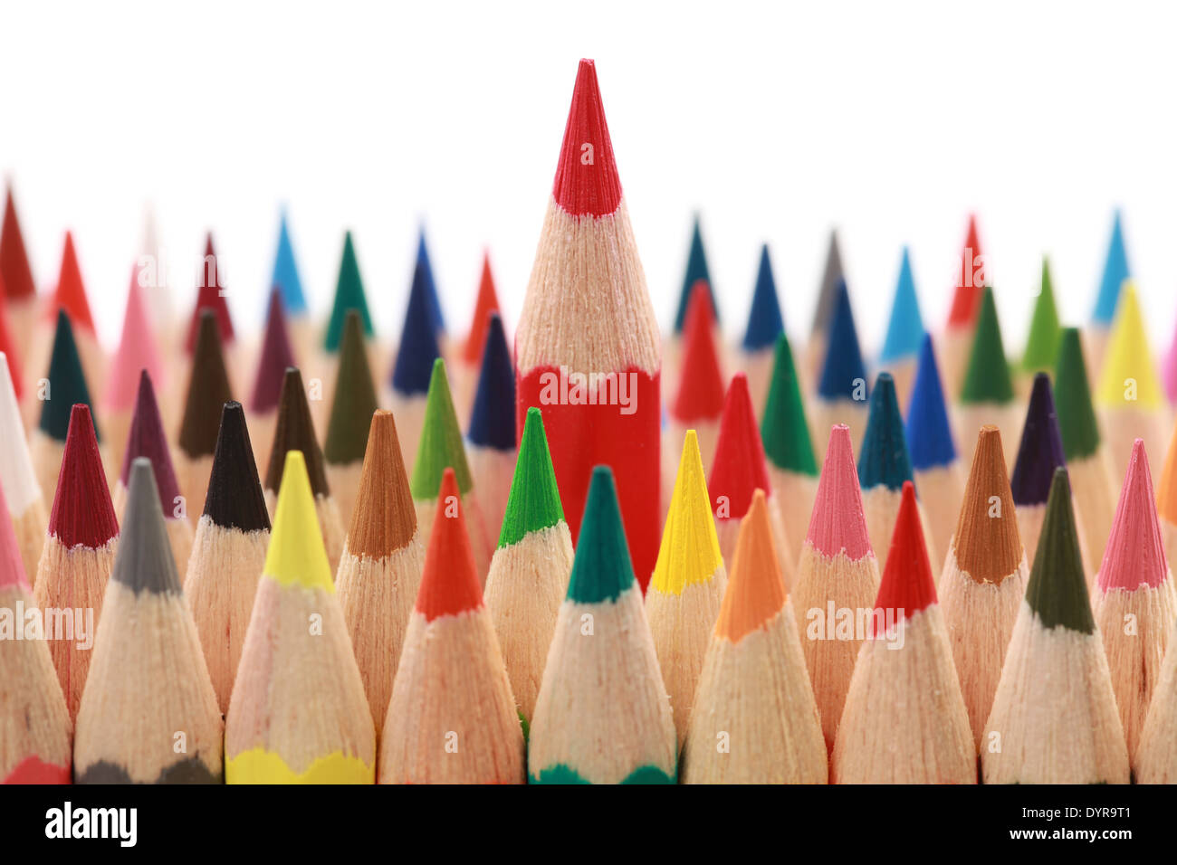 Business concepts: red crayon standing out from the crowd - Stock Image