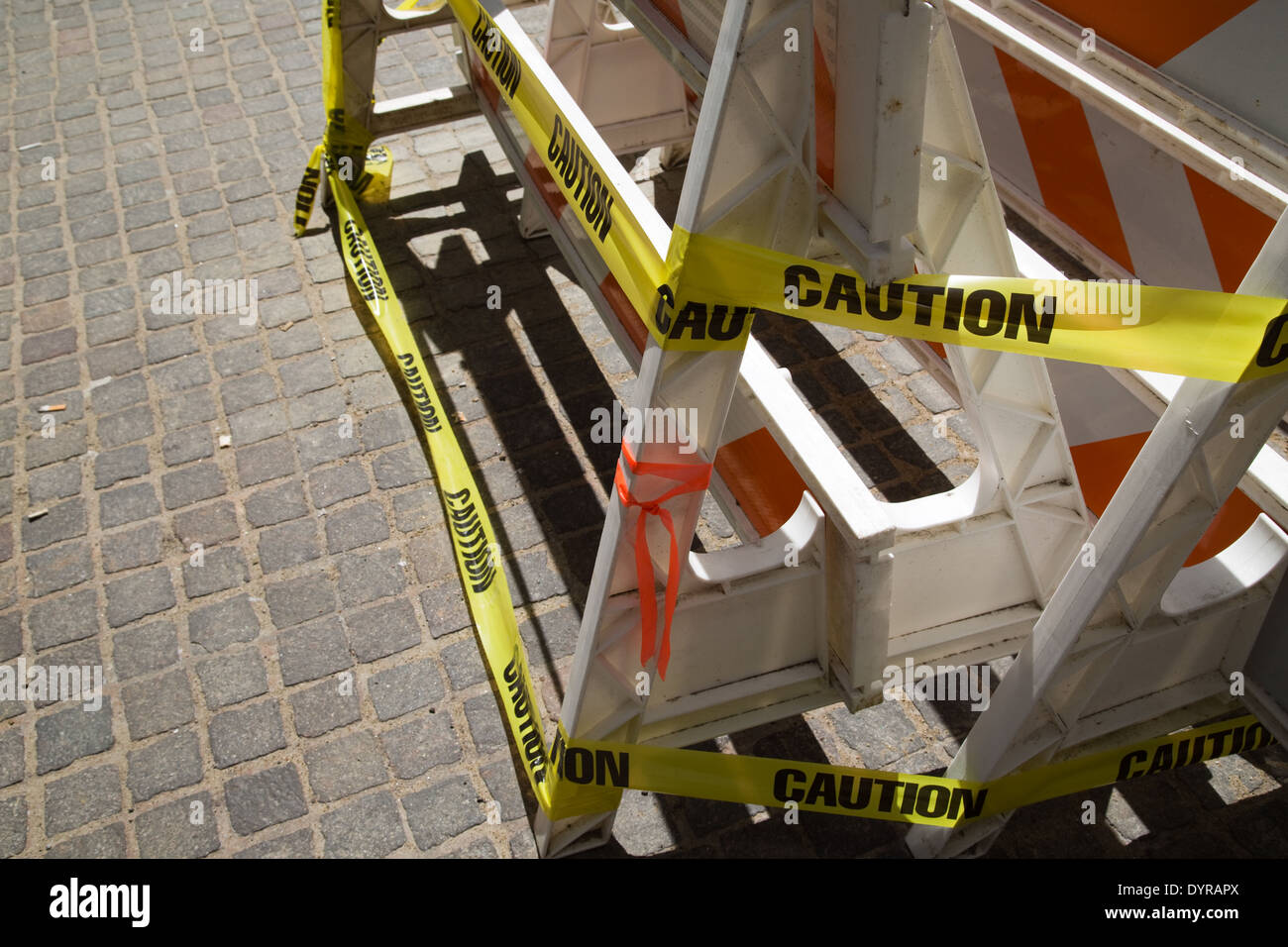 caution tape and construction barricade on new york city street - Stock Image
