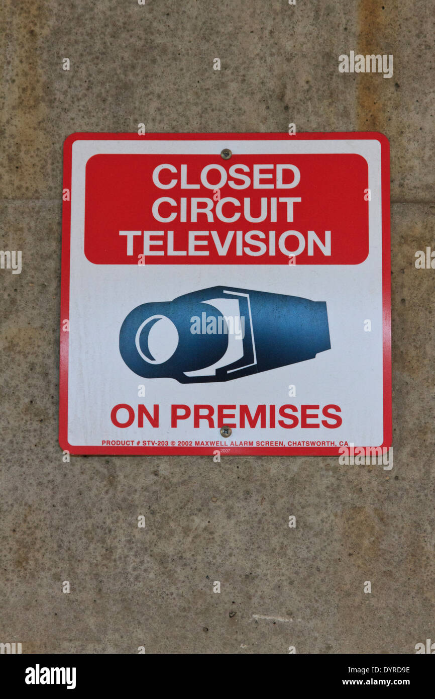 Sign warning that closed circuit television cameras are in use - Stock Image