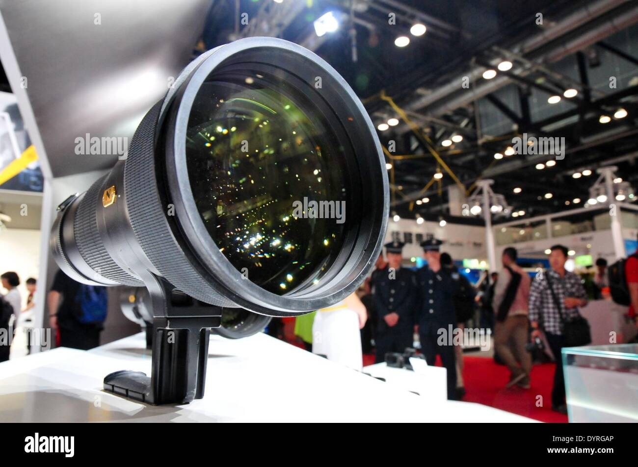 Beijing, China. 25th Apr, 2014. A Nikon lens is seen during the 17th China International Photograph & Electrical Imaging Machinery and Technology Fair in Beijing, capital of China, April 25, 2014. The fair kicked off here on Friday. © Ma Zhiyu/Xinhua/Alamy Live News - Stock Image