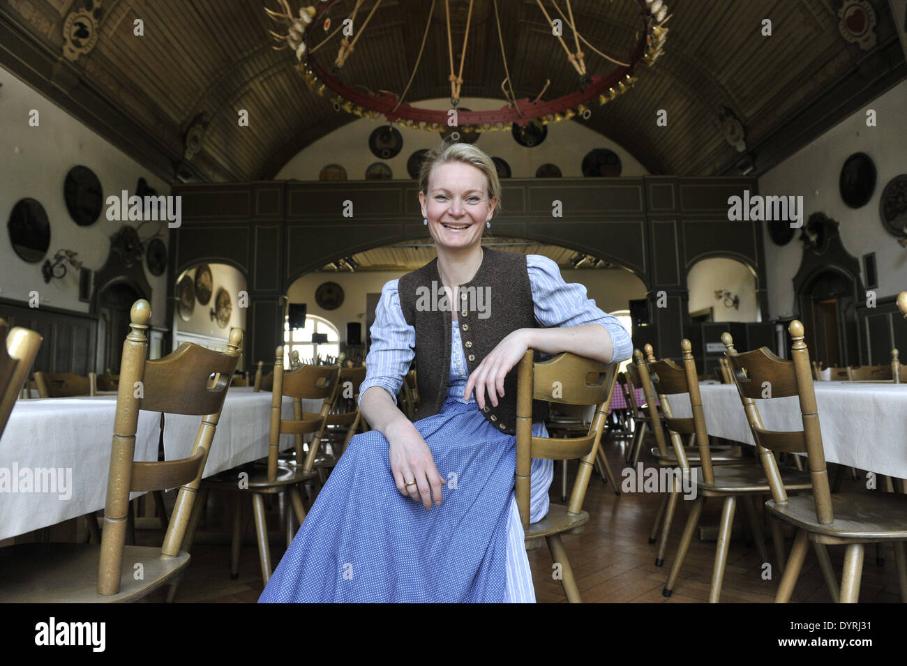 Landlady Gigi Pfundmair in the banquet hall of the 'Muenchner Haupt', 2011 - Stock Image