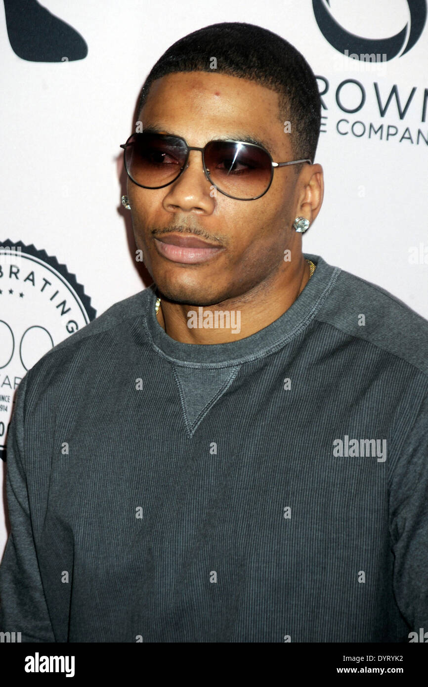 Nelly attends the Brown Shoe Company Celebrates 100 Years on New York Stock Exchange event at 4 World Trade Center on April 23, 2014 in New York City - Stock Image