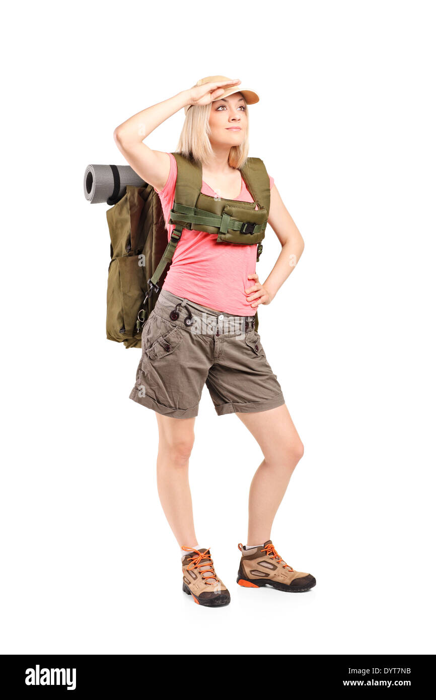 Full length portrait of a female scout with backpack - Stock Image