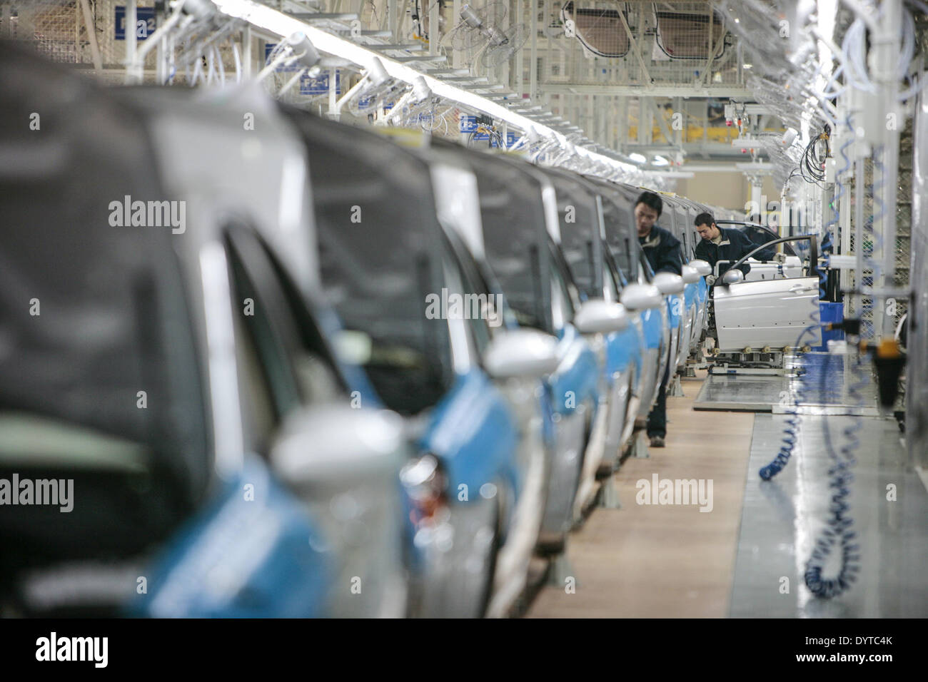Workers assemble at a production line of KIA Motor's Cerato at YanCheng - Stock Image