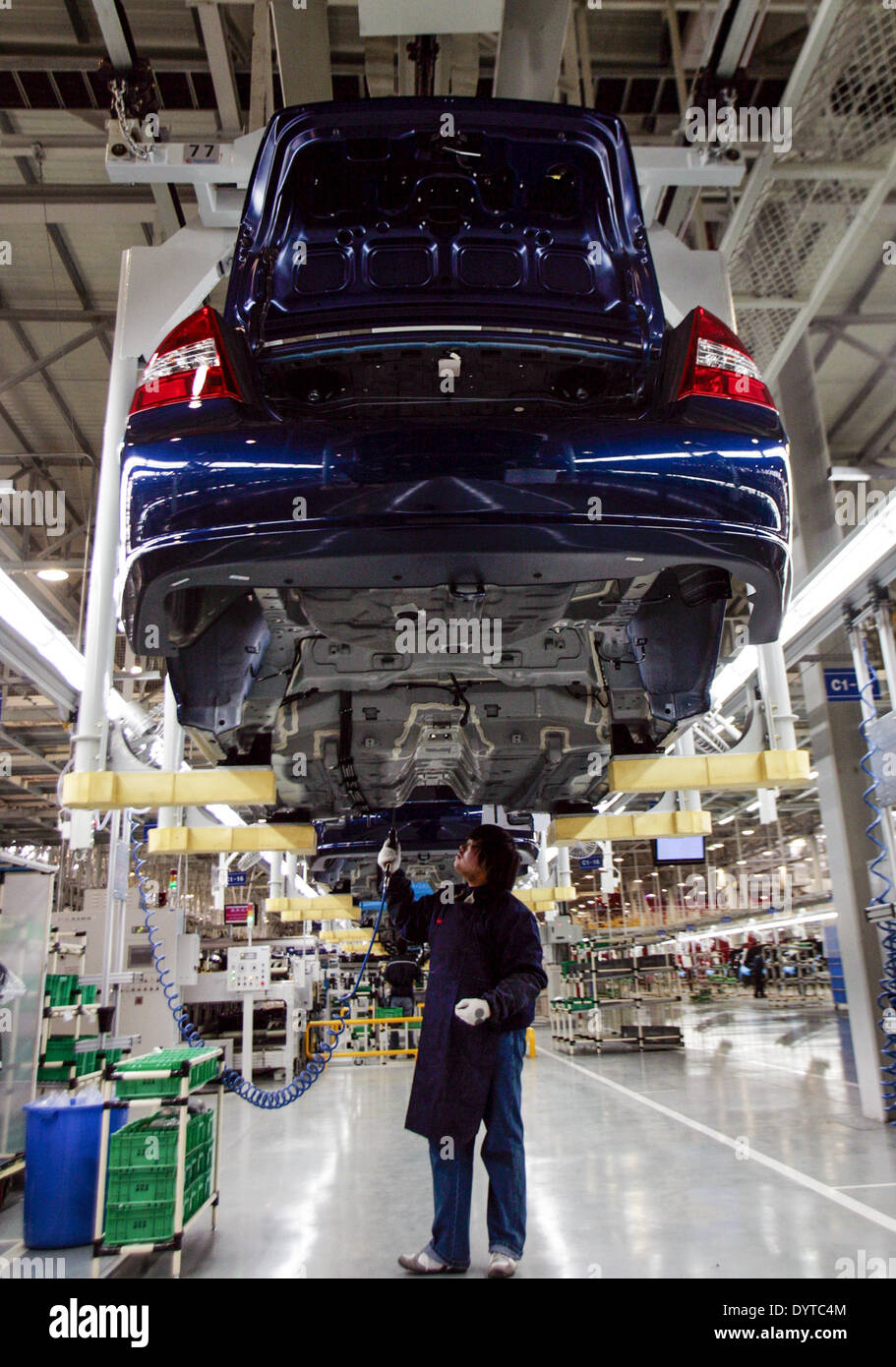 A worker works at a production line of KIA Motor's Cerato at YanCheng - Stock Image