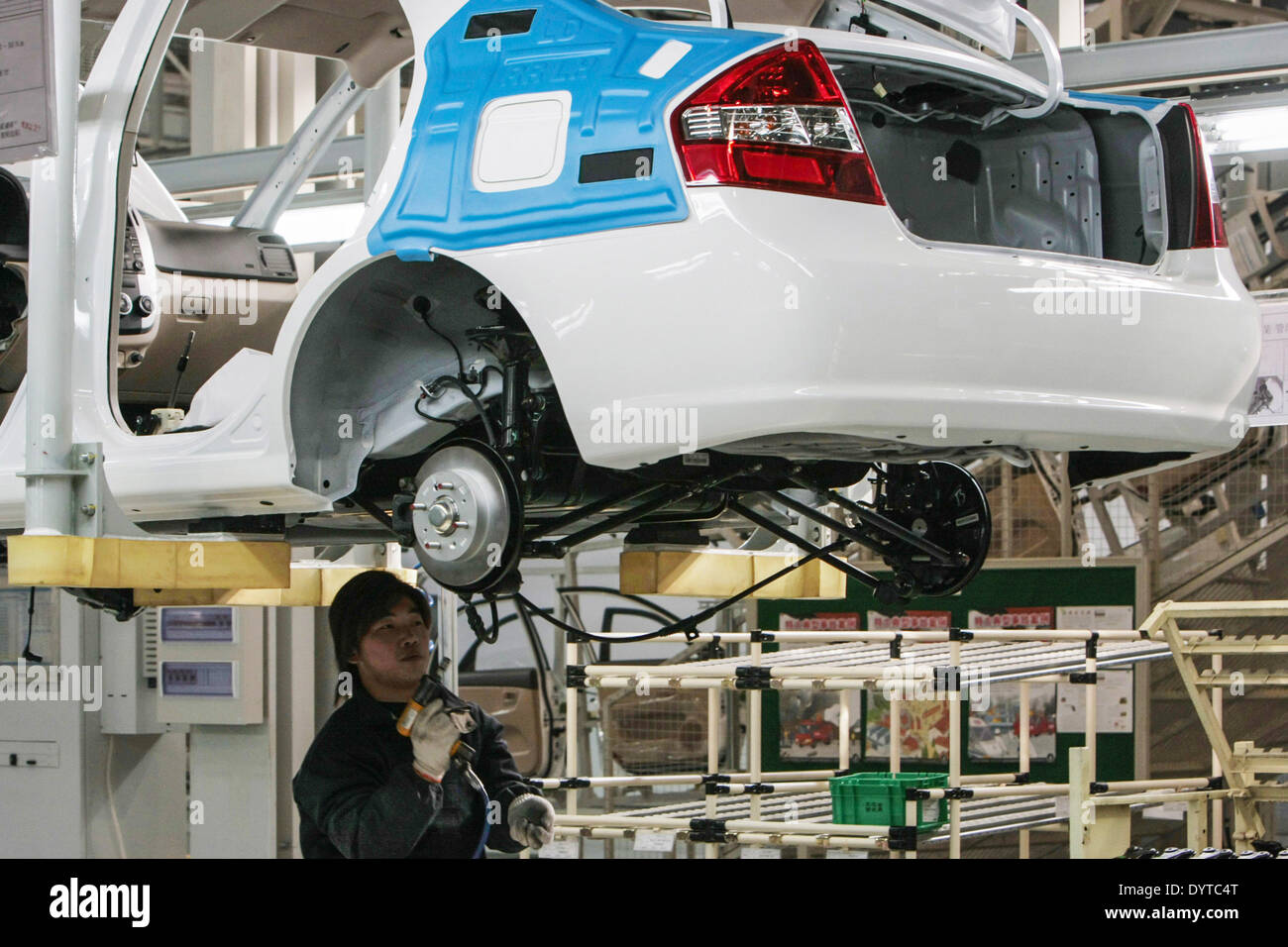 A worker works at a production line of KIA Motors Cerato at YanCheng - Stock Image