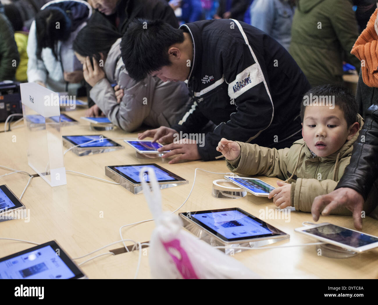 A kid try out Ipad at an Apple store - Stock Image
