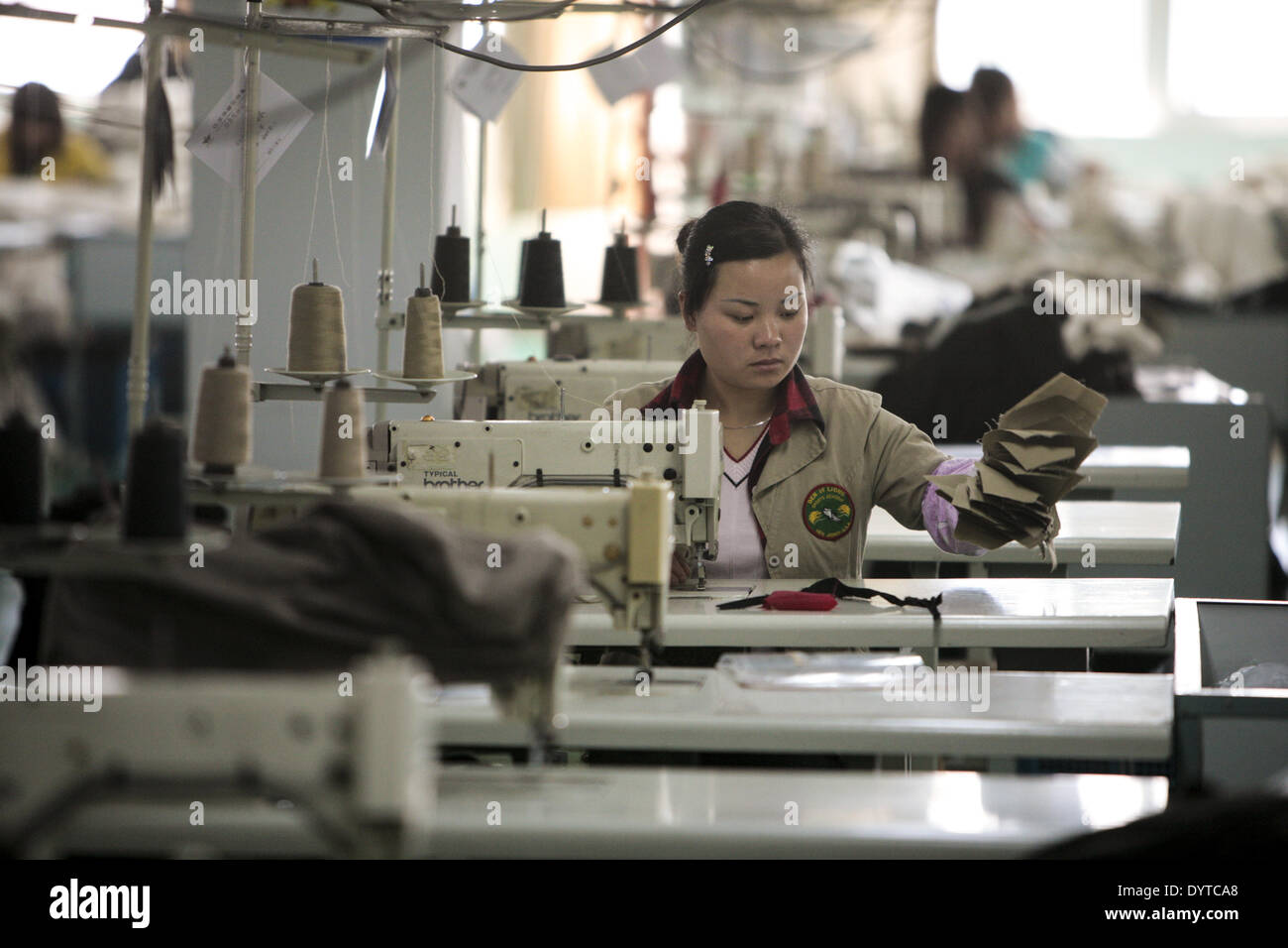 Workers assemble garments at the Ever- Glory International Group factory in Nanjing - Stock Image