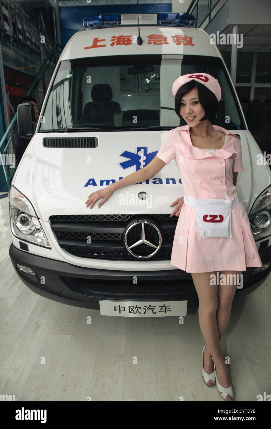 A model stands besides an ambulance vehicle by ZOEMO - Stock Image