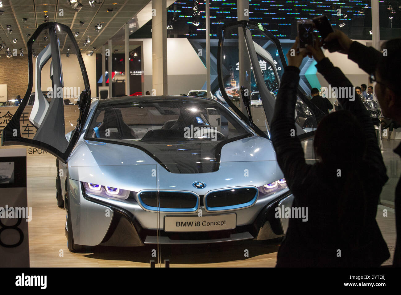 Visitors take pictures of a BMW's iconcept at Auto Shanghai 2013 - Stock Image