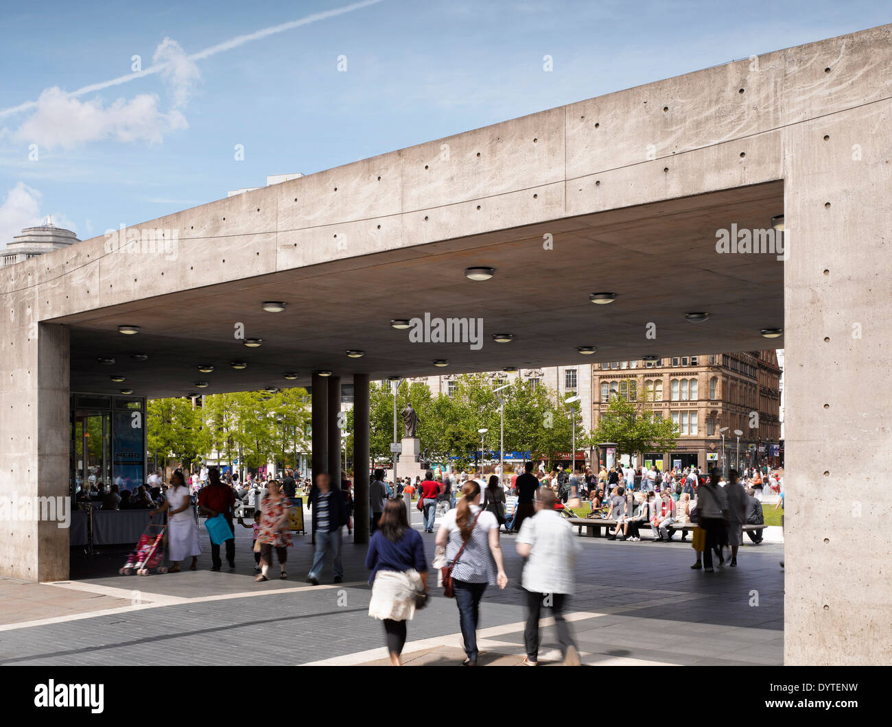 Shoppers visit the urban piazza at Piccadilly Place site, Manchester, Greater Manchester. - Stock Image