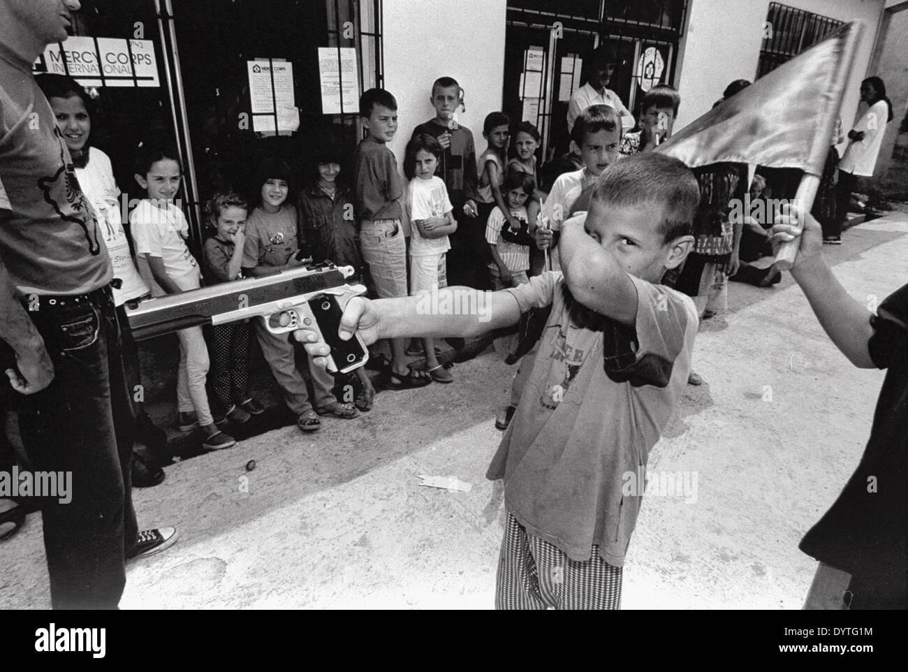 Children play war in Kosovo Stock Photo