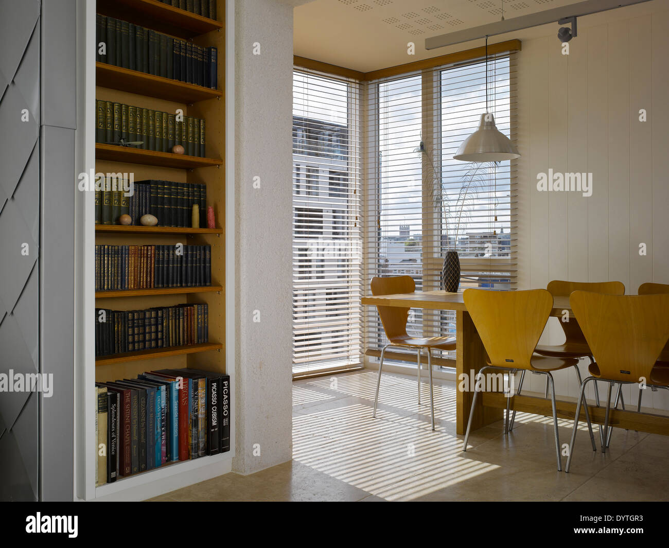 Table and chairs in modern dining room, Southwark Penthouse, London - Stock Image