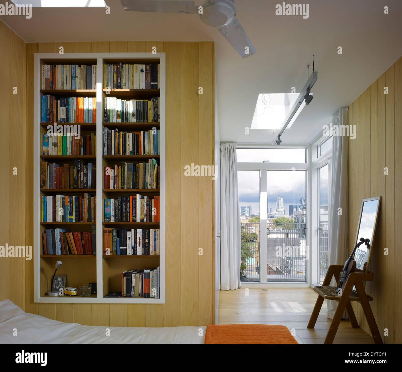 Built in bookcase in modern bedroom Southwark