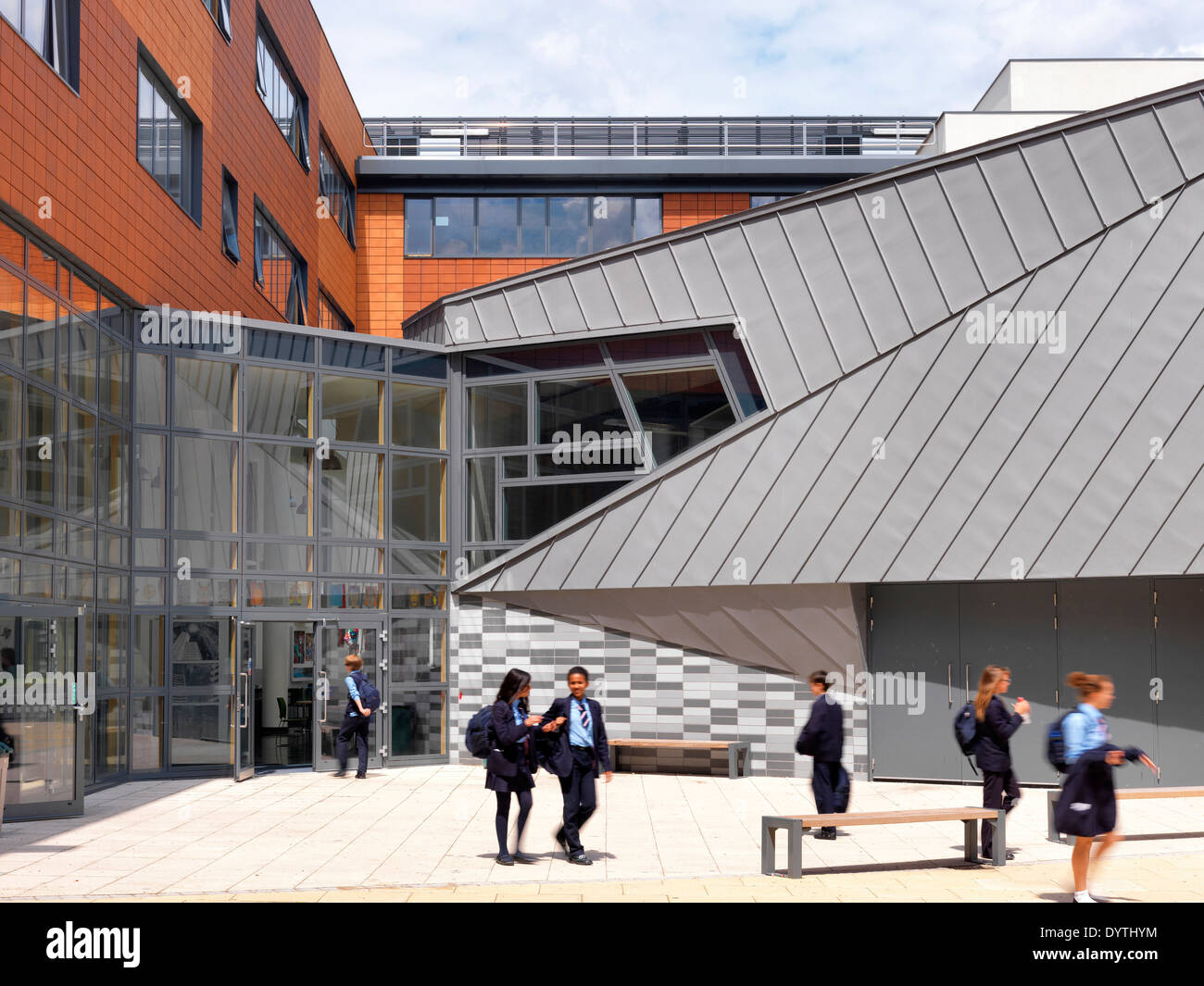 Schoolchildren outside the exterior of Pimlico Academy, Library and Adult Education centre, London - Stock Image