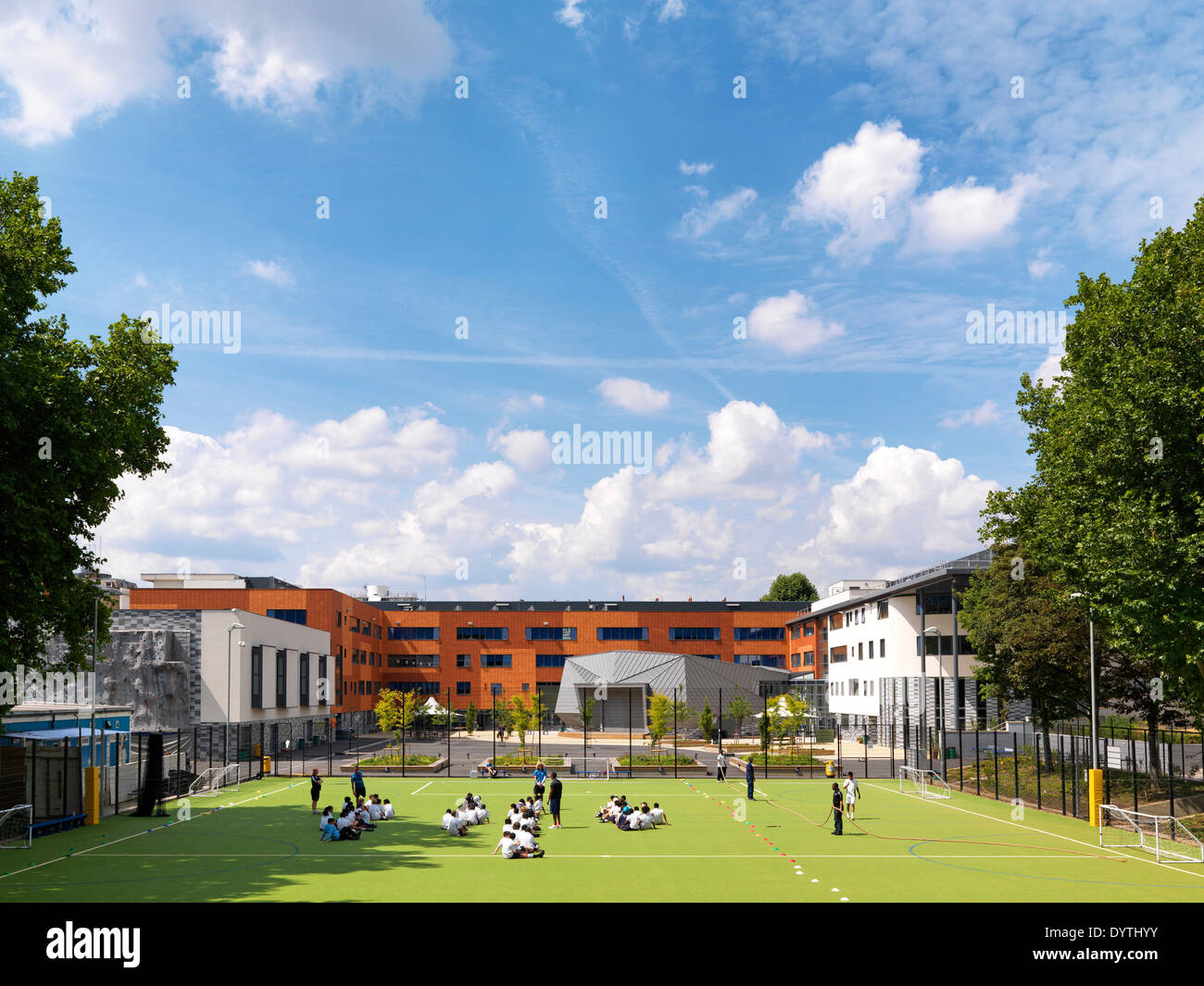 Schoolchildren in playing field of Pimlico Academy, Library and Adult Education centre, London - Stock Image