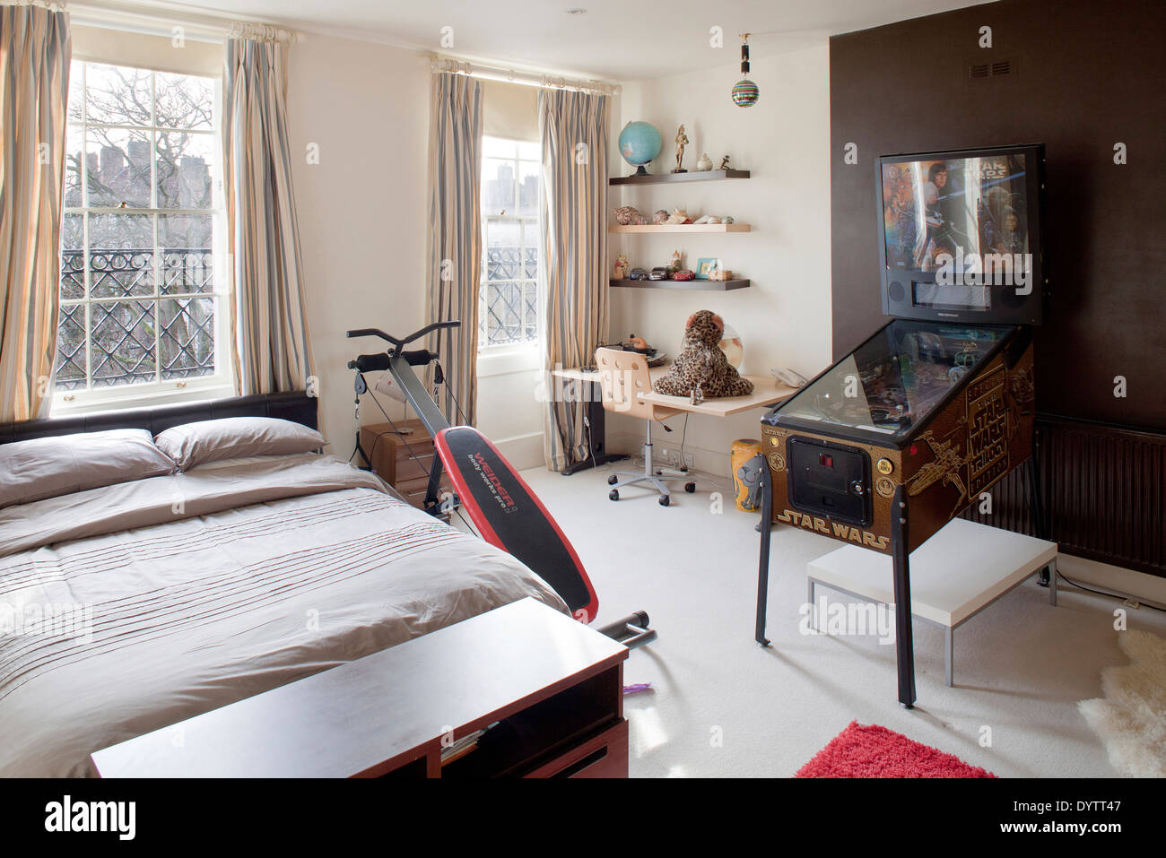 Teenagers bedroom with pinball machine London Stock Photo 68772599