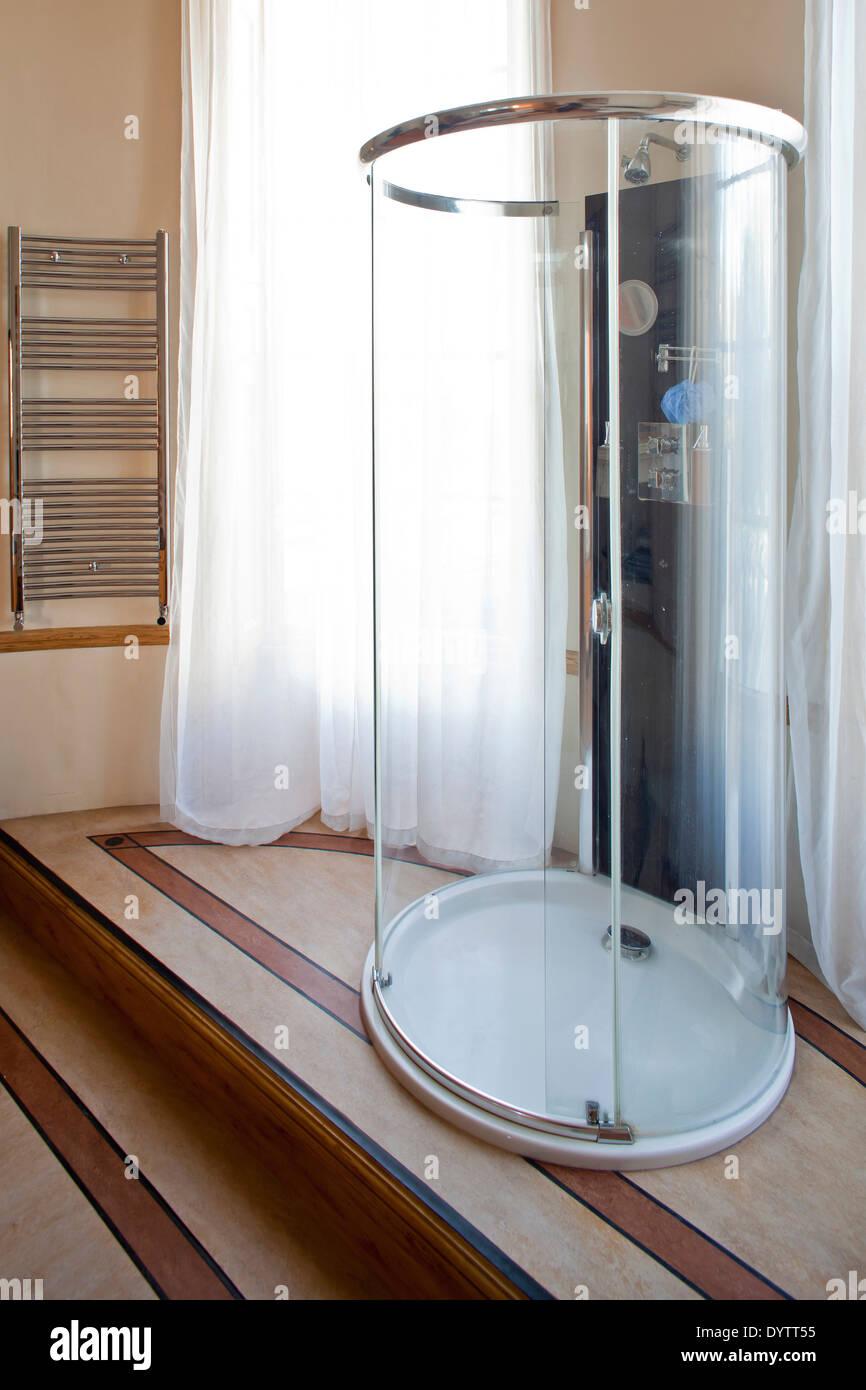 Oval Shaped Freestanding Shower Unit In Modern Bathroom London