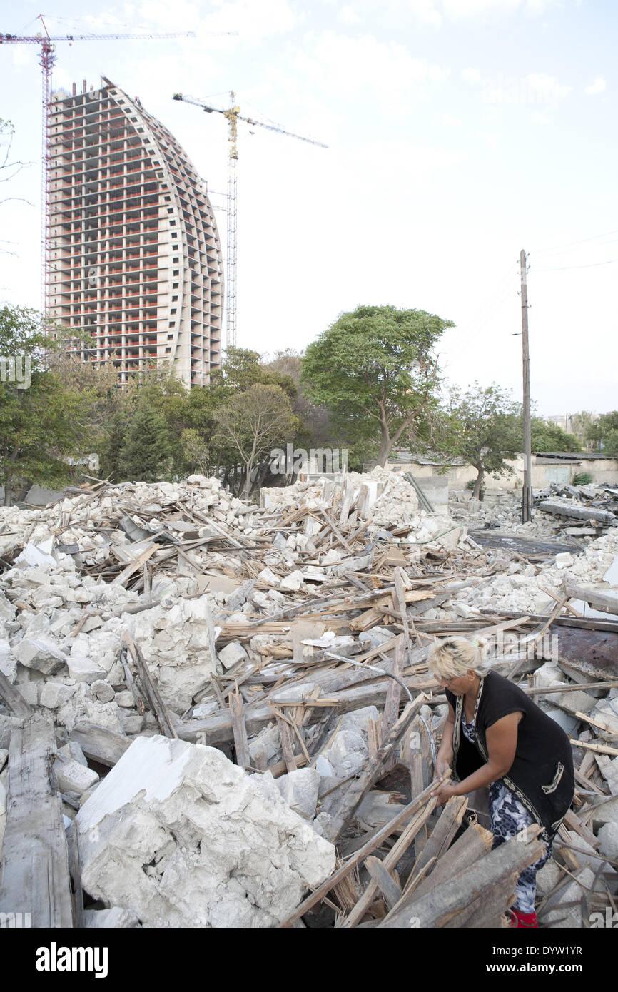 Woman in her demolished house, Baku 2011 - Stock Image