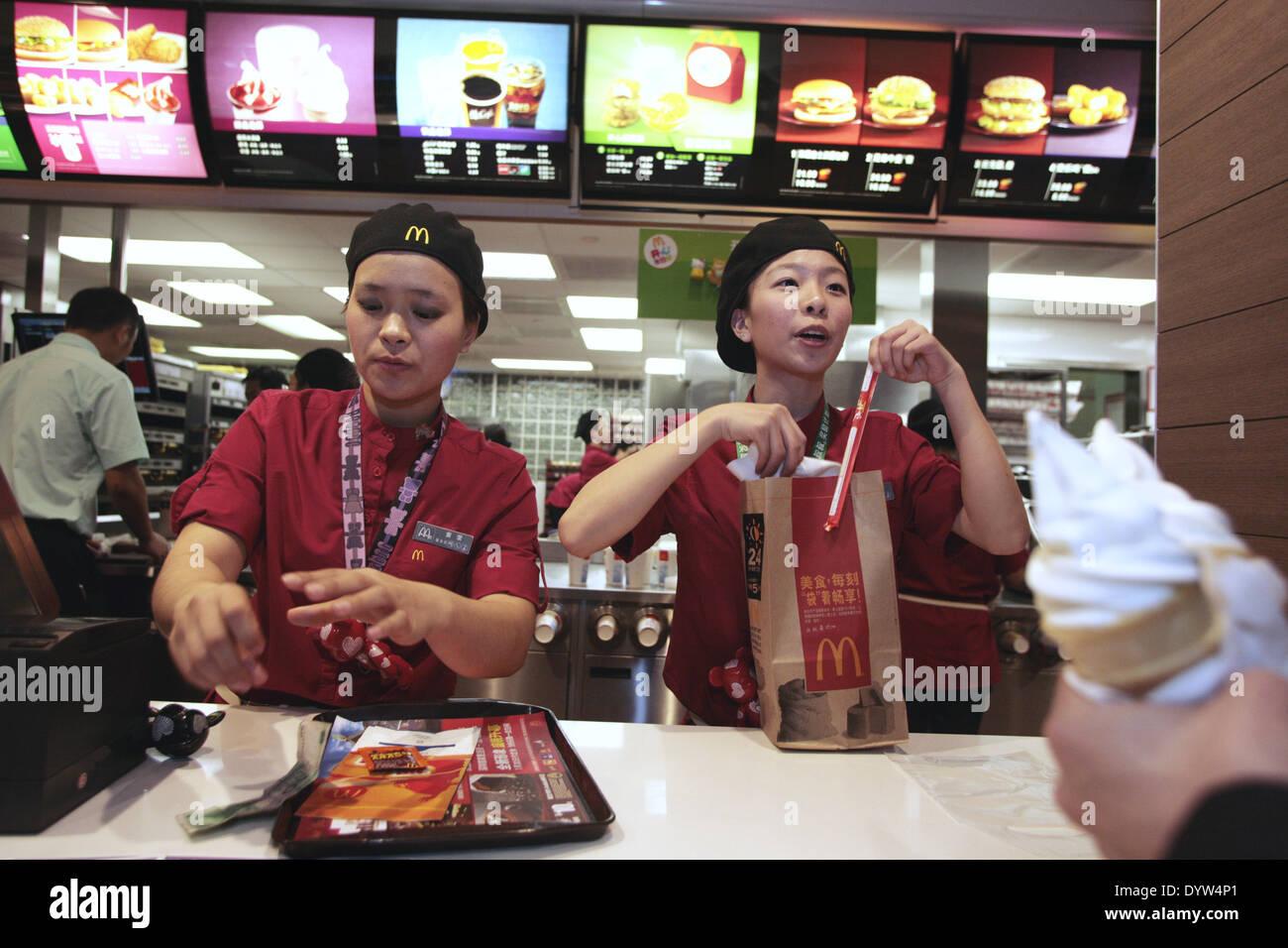 Mcdonalds staff serves food to customer - Stock Image