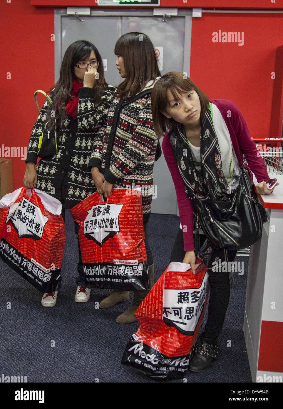 Customers carry branded shopping bag in a Media Markt store in Shanghai - Stock Image