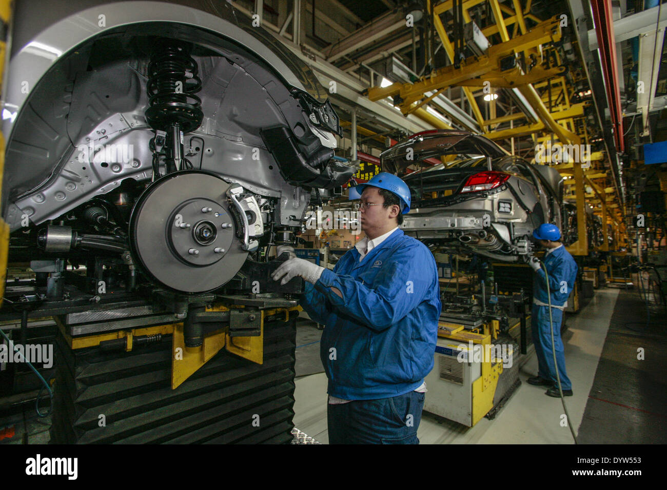 Workers assemble General Motors (GM) Co - Stock Image