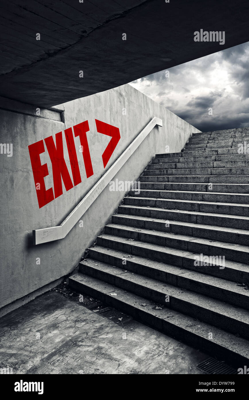 Exit on Urban staircase in underground passage with exit to dark stormy sky. Stock Photo