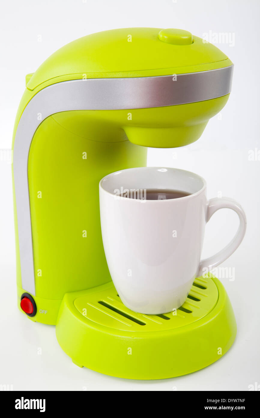 coffee maker with cup full and ready to drink - Stock Image