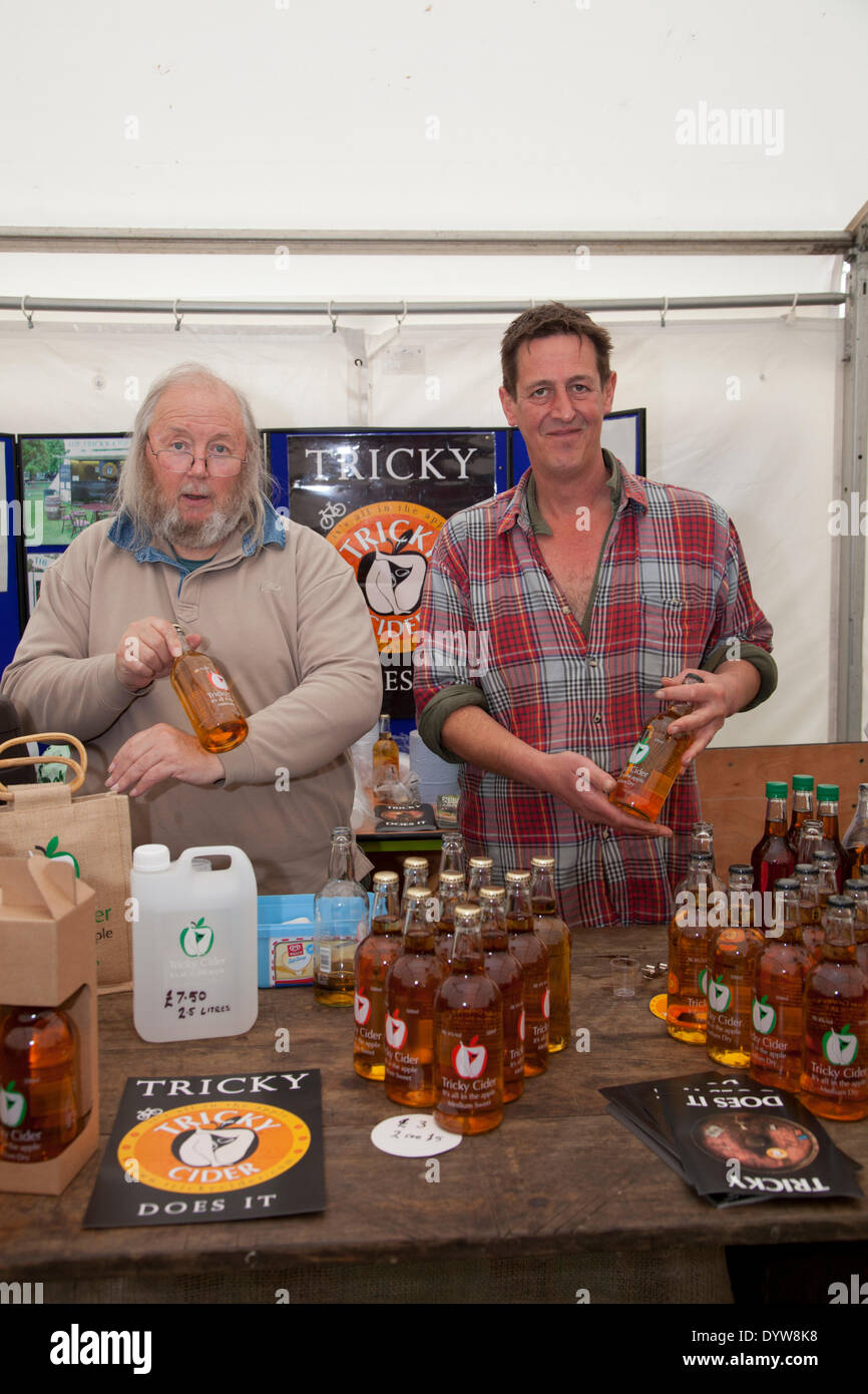 Exeter, UK. 25th April, 2014.Tricky Cider. Westcountry Somerset cider producers The Exeter Festival of Southwest  Food and Drink Fair, three day festival of local produce and cooking. Steve Watkins (bearded) and Alistair Bryce Credit:  Anthony Collins/Alamy Live News - Stock Image