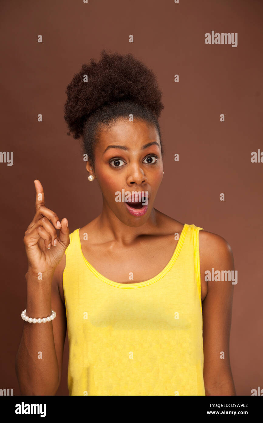 African American female shows emotion with facial expressions and body language - Stock Image