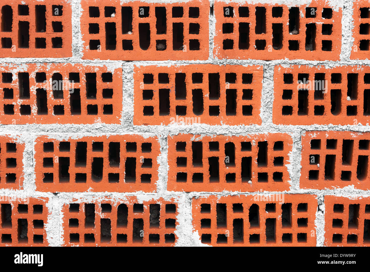 background of wall of red bricks with cement - Stock Image