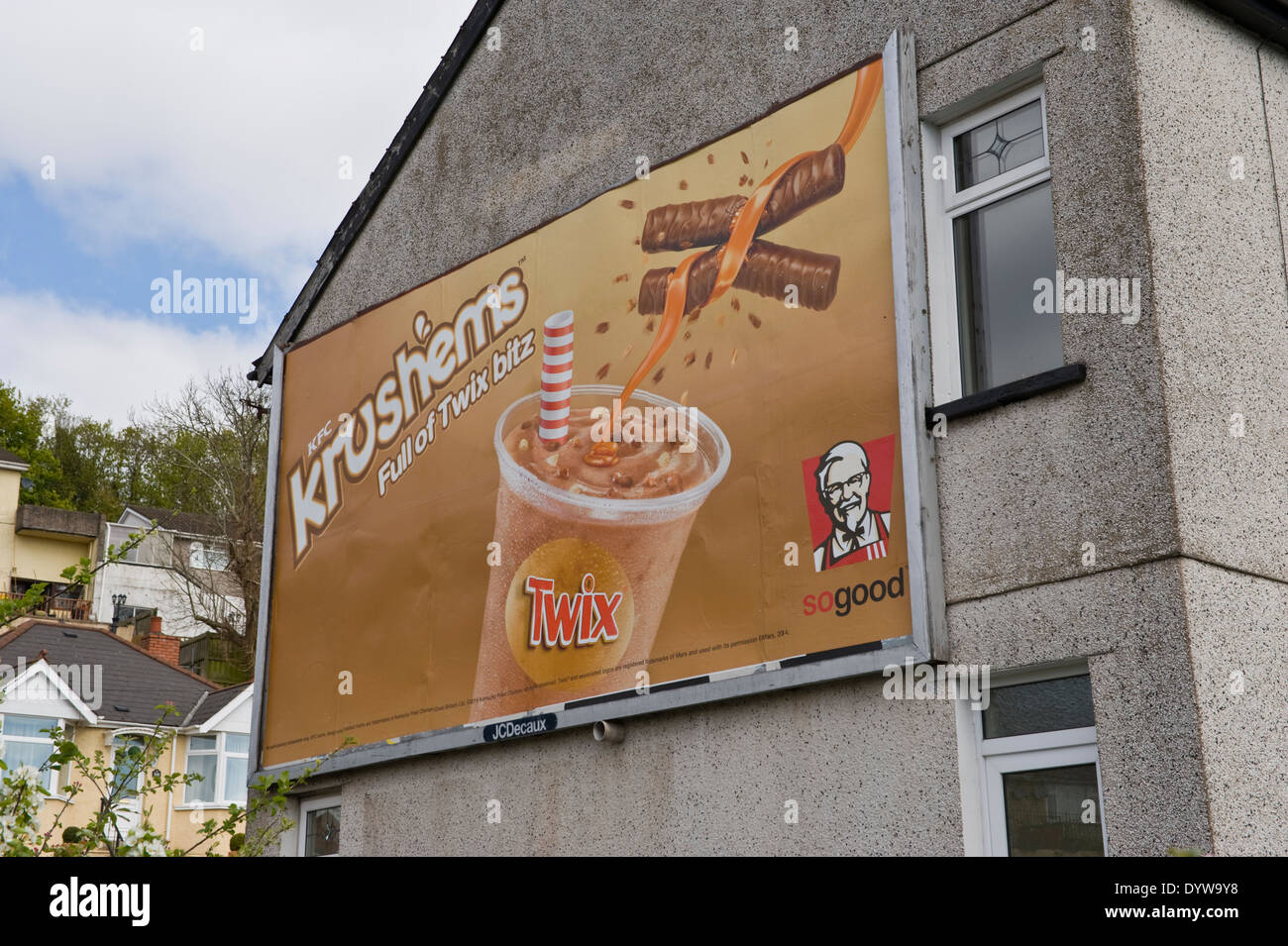 KFC Krushems with Twix advertising billboard on JCDecaux site on side wall of house in Newport South Wales UK - Stock Image