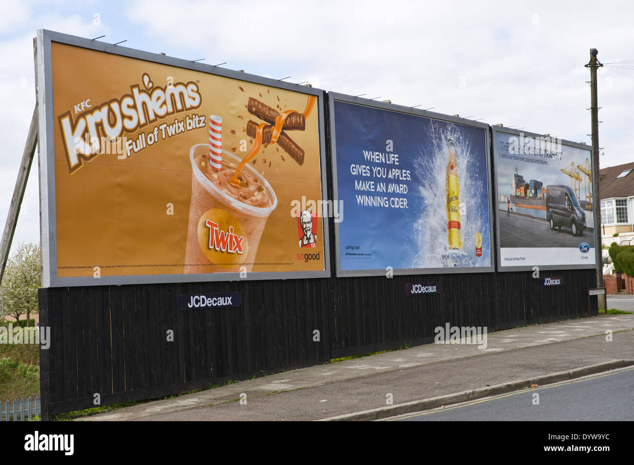 KFC Krushems with Twix, Carling Cider & Ford Transit Van advertising billboards on JCDecaux roadside site in Newport South Wales UK - Stock Image